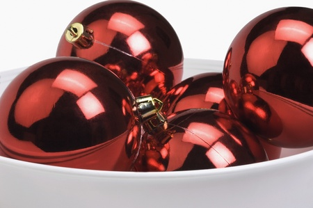 Close-up of red baubles in a bowl photo