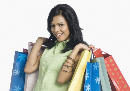 Woman carrying shopping bags and smiling Stock Photo - 10123439