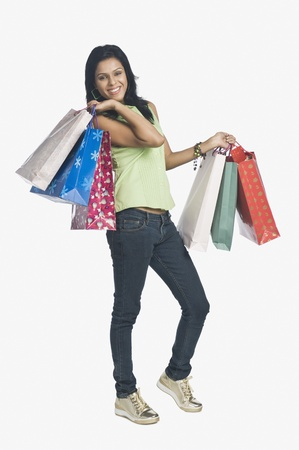 commerce: Woman carrying shopping bags and smiling