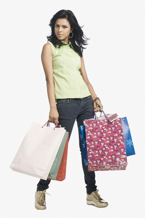 Portrait of a woman carrying shopping bags