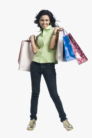 spending full: Woman carrying shopping bags and smiling