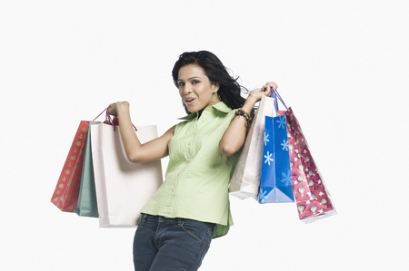 Woman carrying shopping bags and smiling Stock Photo - 10123406