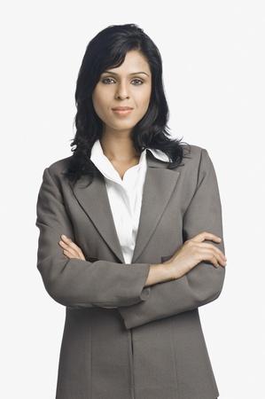 smirking: Portrait of a businesswoman smirking