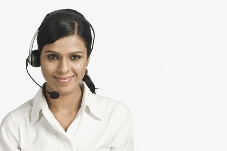 Portrait of a female customer service representative smiling Stock Photo - 10123425