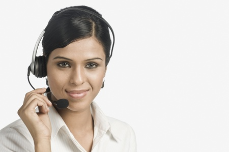 Portrait of a female customer service representative smiling Stock Photo - 10123455