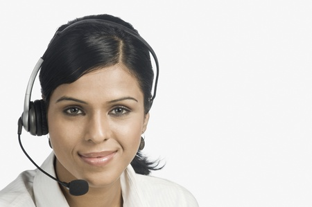 customer service representative: Portrait of a female customer service representative smiling