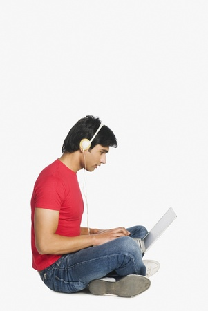 Man working on a laptop Stock Photo - 10123434