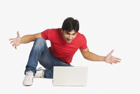 net surfing: Man looking at a laptop and surprised