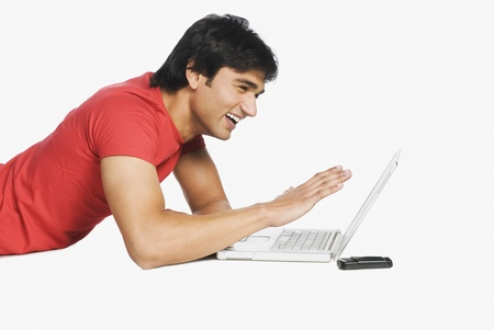 Man working on a laptop Stock Photo - 10123428