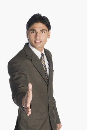 Businessman offering a handshake Stock Photo