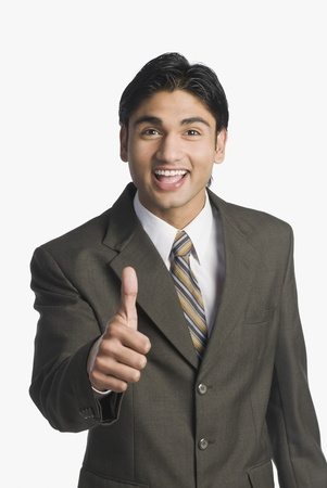 Businessman showing thumbs-up sign Stock Photo - 10169540