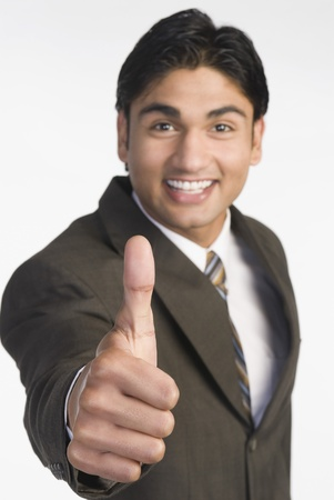 Businessman showing thumbs-up sign Stock Photo - 10123447