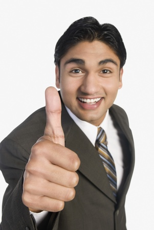 Businessman showing thumbs-up sign