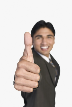 Businessman showing thumbs-up sign Stock Photo - 10123381