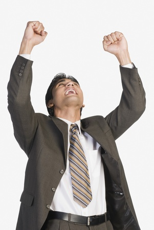 Businessman clenching fists in excitement Stock Photo - 10169556