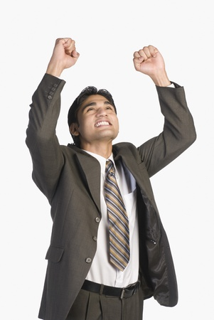 Businessman clenching fists in excitement Stock Photo - 10126368