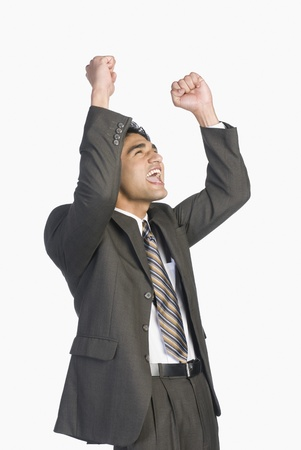 Businessman clenching fists in excitement Stock Photo - 10126357