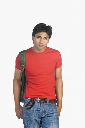 Portrait of a man carrying a bag