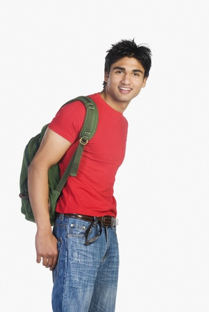 work path: Man carrying a bag and smiling