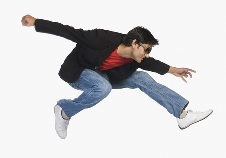 Man jumping in mid-air Stock Photo - 10123411