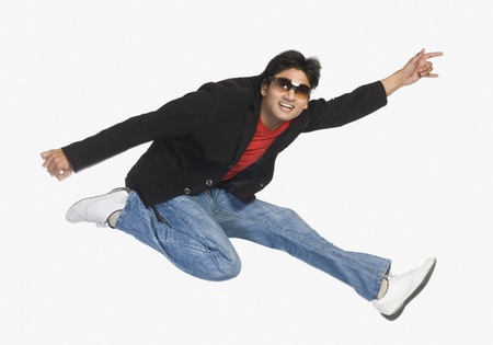 Man jumping in mid-air Stock Photo - 10123416