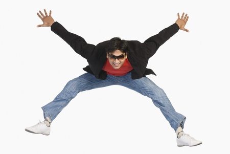 Man jumping in mid-air Stock Photo - 10123379