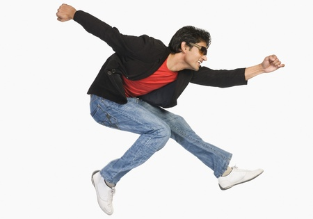 no movement: Man jumping in mid-air