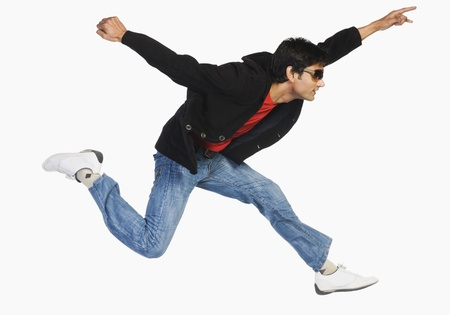 Man jumping in mid-air Stock Photo - 10123383