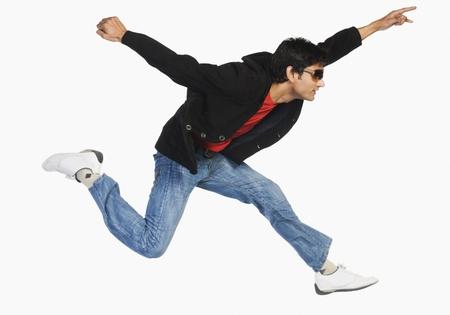 work path: Man jumping in mid-air