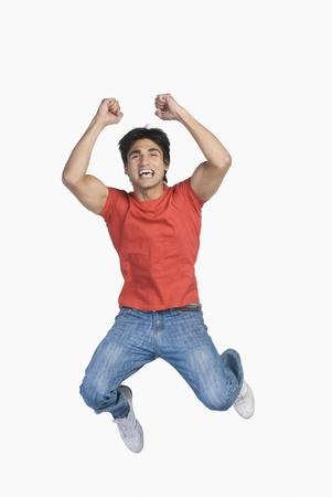 winning location: Man jumping in mid-air