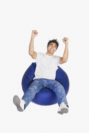 bean bag: Man clenching his fists in excitement