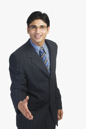 Businessman offering a handshake Imagens