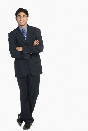 full height: Portrait of a businessman smiling LANG_EVOIMAGES