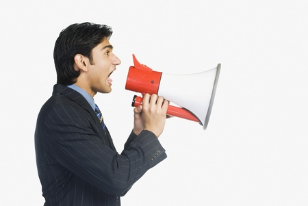 Businessman with a megaphone Stock Photo - 10123421