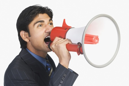 commerce communication: Businessman holding a megaphone