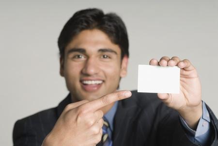 Businessman holding a blank placard Banco de Imagens
