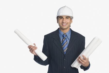 construction draftsman: Architect holding blueprints