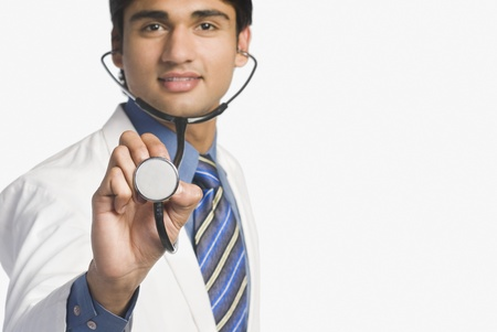 healthy path: Doctor holding a stethoscope LANG_EVOIMAGES