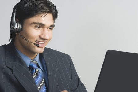 Customer service representative wearing a headset Stock Photo