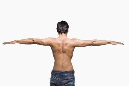 bare chest: Rear view of a man stretching