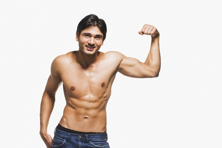 Portrait of a man showing his biceps Stock Photo - 10123430