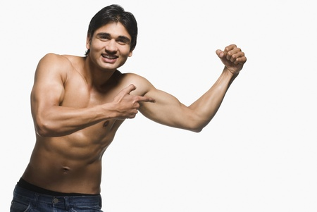 energy work: Portrait of a man showing his biceps