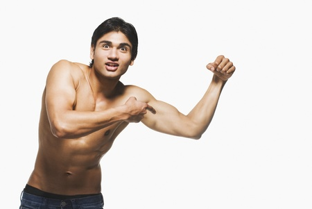 Portrait of a man showing his biceps Stock Photo - 10123389