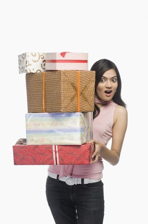 Portrait of a woman holding gift boxes