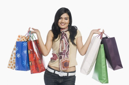 Woman carrying shopping bags and smiling Stock Photo - 10123437