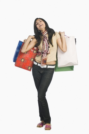no people: Woman carrying shopping bags and smiling