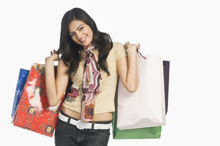 Woman carrying shopping bags and smiling Stock Photo - 10123449
