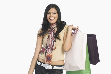 blissfulness: Woman carrying shopping bags and smiling