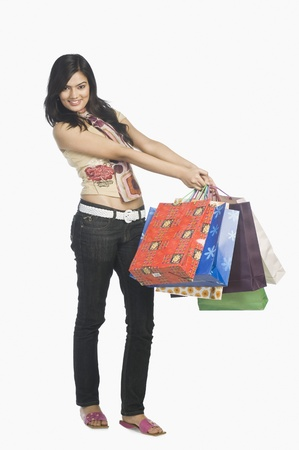 merchandise: Woman carrying shopping bags and smiling