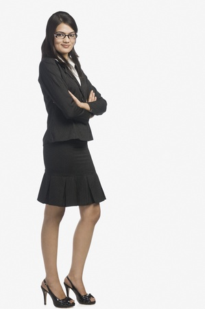 no heels: Portrait of a businesswoman standing with her arms crossed